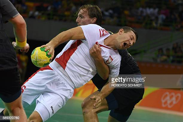 TOPSHOT Poland's centre back Przemyslaw Krajewski vies with a Swedish player during the men's preliminaries Group B handball match Sweden vs Poland...