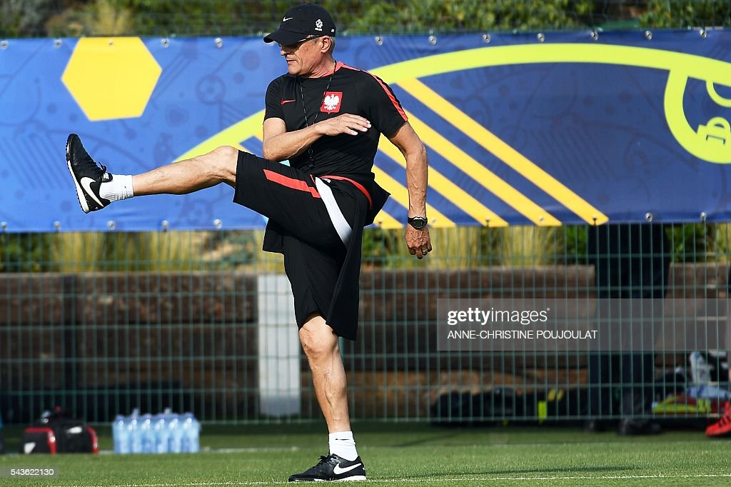 Poland's coach Adam Nawalka attends a training session at the Robert-Louis-Dreyfus stadium in Marseille, southeastern France, on June 29, 2016, on the eve of their Euro 2016 quarter-final football match against Portugal. / AFP / ANNE