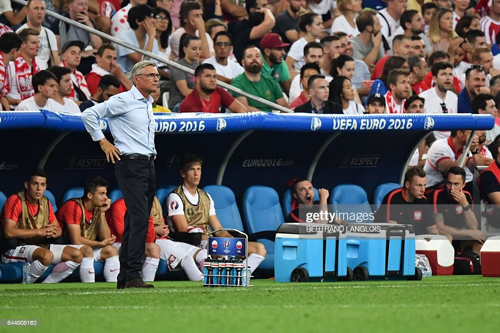 Poland's coach Adam Nawalka reacts during the Euro 2016 quarter-final football match between Poland and Portugal at the Stade Velodrome in Marseille on June 30, 2016. / AFP / BERTRAND