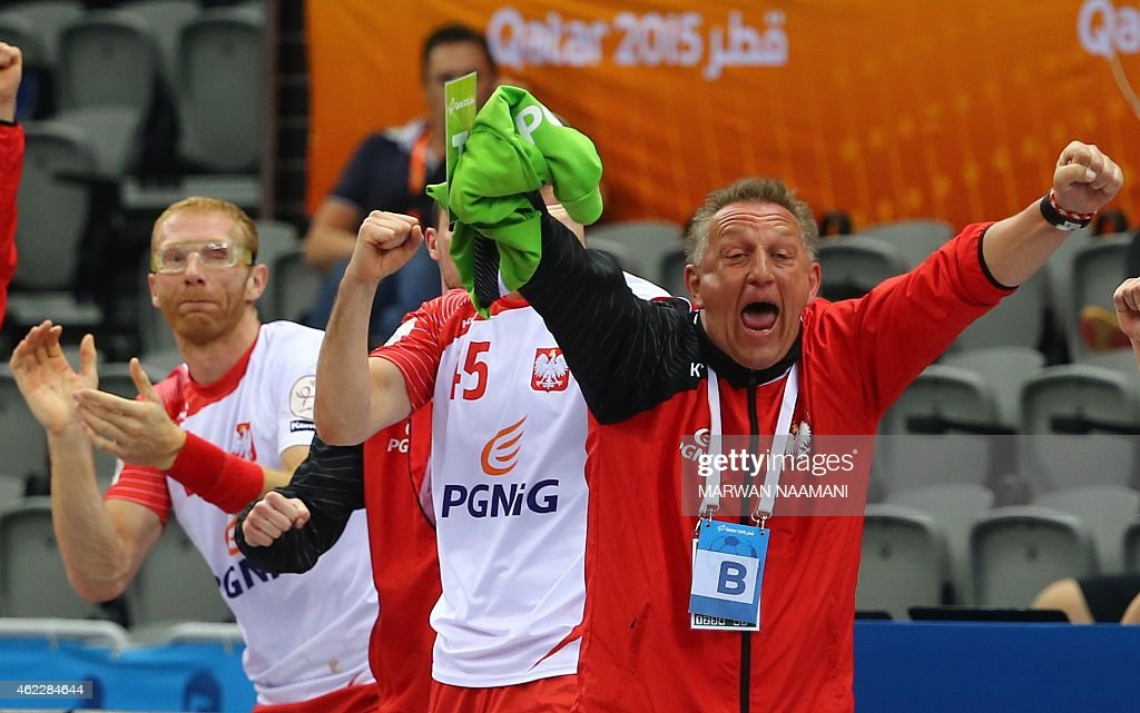 Poland's coach <a gi-track='captionPersonalityLinkClicked' href=/galleries/search?phrase=Michael+Biegler&family=editorial&specificpeople=2506225 ng-click='$event.stopPropagation()'>Michael Biegler</a> (R) celebrates their win during the 24th Men's Handball World Championships Eighth Final EF2 match between Poland and Sweden at the Ali Bin Hamad Al Attiya Arena in Doha on January 26, 2015.