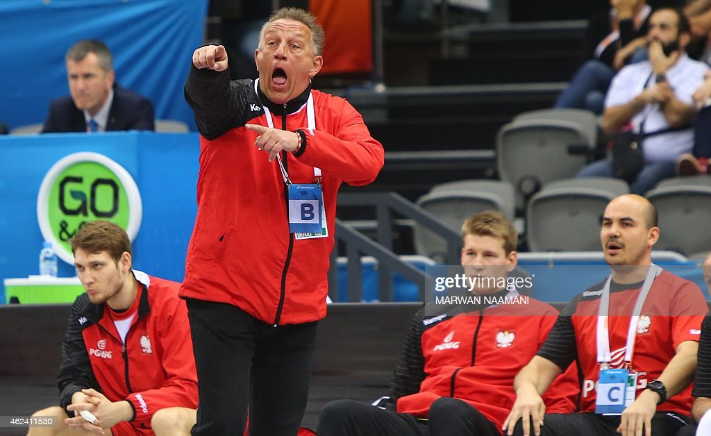 Poland's coach <a gi-track='captionPersonalityLinkClicked' href=/galleries/search?phrase=Michael+Biegler&family=editorial&specificpeople=2506225 ng-click='$event.stopPropagation()'>Michael Biegler</a> (2L) gestures during the 24th Men's Handball World Championships quarterfinals match between Poland and Croatia at the Ali Bin Hamad Al Attiya Arena in Doha on January 28, 2015.