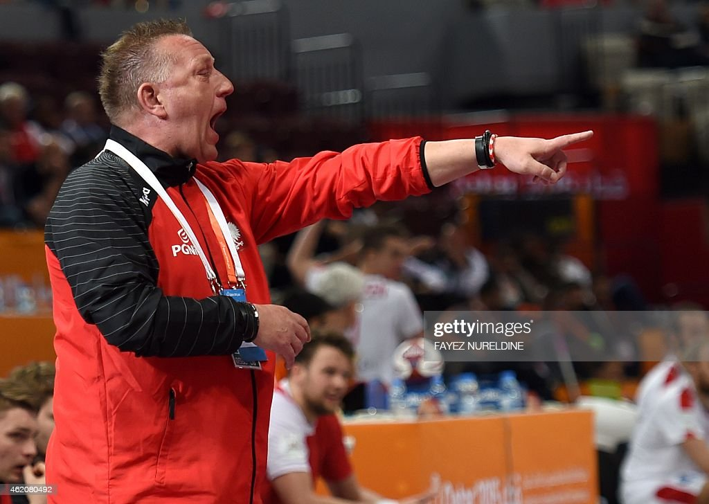 Poland's coach <a gi-track='captionPersonalityLinkClicked' href=/galleries/search?phrase=Michael+Biegler&family=editorial&specificpeople=2506225 ng-click='$event.stopPropagation()'>Michael Biegler</a> reacts on the sidelines during the 24th Men's Handball World Championships preliminary round Group D match between Denmark and Poland at the Lusail Multipurpose Hall in Doha on January 24, 2015.