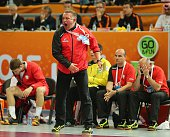 Poland's coach Michael Biegler shouts during the 24th Men's Handball World Championships semifinals match between Qatar and Poland at the Lusail...