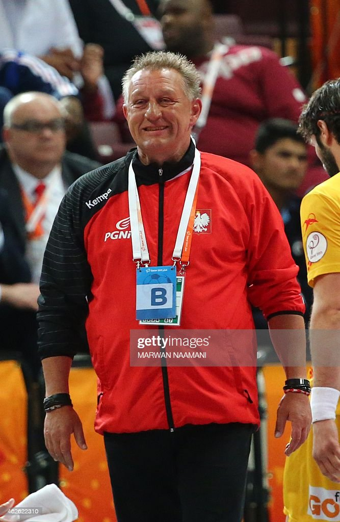 Poland's coach <a gi-track='captionPersonalityLinkClicked' href=/galleries/search?phrase=Michael+Biegler&family=editorial&specificpeople=2506225 ng-click='$event.stopPropagation()'>Michael Biegler</a> smiles during the 24th Men's Handball World Championships 3rd place match between Spain and Poland at the Lusail Multipurpose Hall in Doha on February 1, 2015.