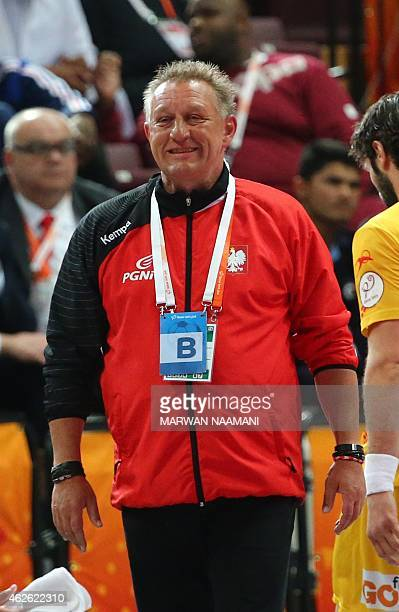 Poland's coach Michael Biegler smiles during the 24th Men's Handball World Championships 3rd place match between Spain and Poland at the Lusail...