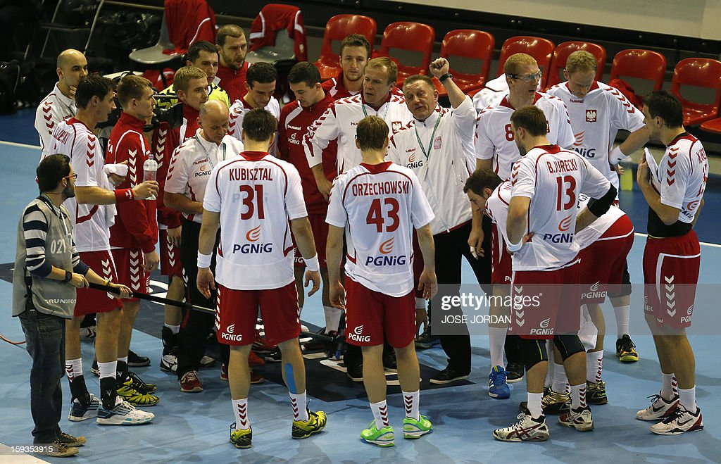 Poland's coach Michael Biegler speaks with his players during the 23rd Men's Handball World Championships preliminary round Group C match Poland vs Belarus at the Pabellon Principe Felipe in Zaragoza on January 12, 2013.