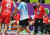 Poland's coach Michael Biegler talks to his players during the 24th Men's Handball World Championships preliminary round Group D match between...