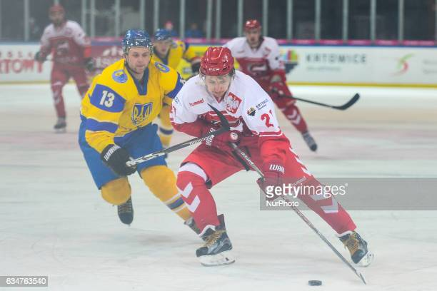 Poland's Damian Kapica in action against Ukraine's Volodymyr Romanenko during an EURO ICE Hockey tournament Match at Spodek Arena in Katowice On...