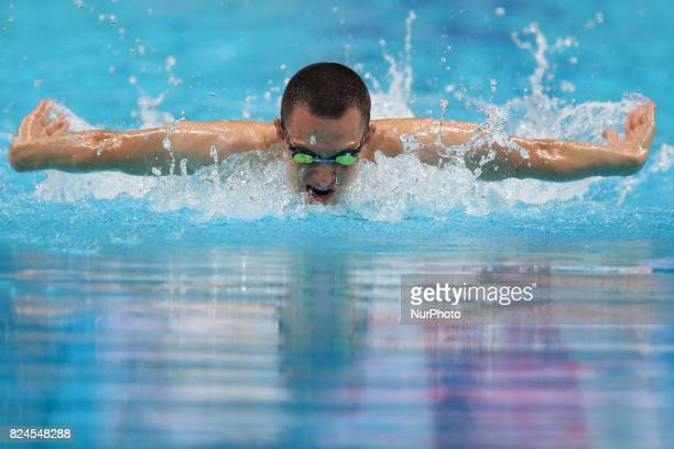 Poland's Dawid Szwedzki competes in a heat of the men's 400m individual medley during the swimming competition at the 2017 FINA World Championships...