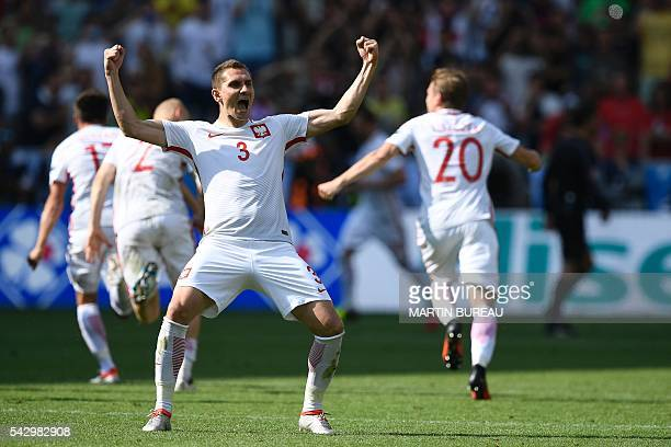 TOPSHOT Poland's defender Artur Jedrzejczyk celebrates after his team wins during the Euro 2016 round of sixteen football match Switzerland vs Poland...