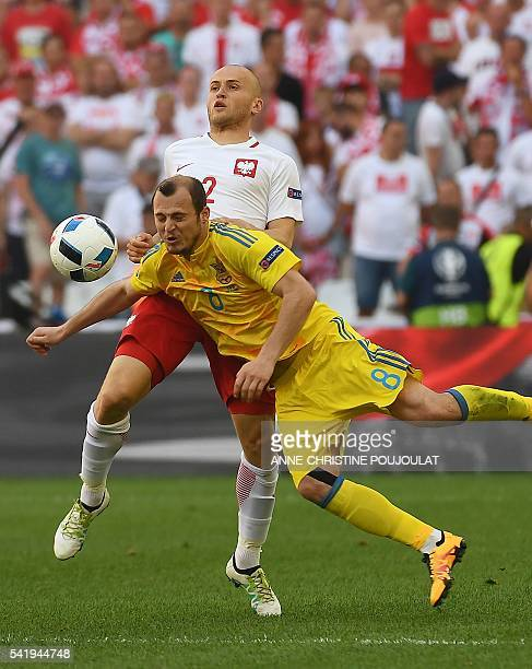 Poland's defender Michal Pazdan vies with Ukraine's forward Roman Zozulya during the Euro 2016 group C football match between Ukraine and Poland at...
