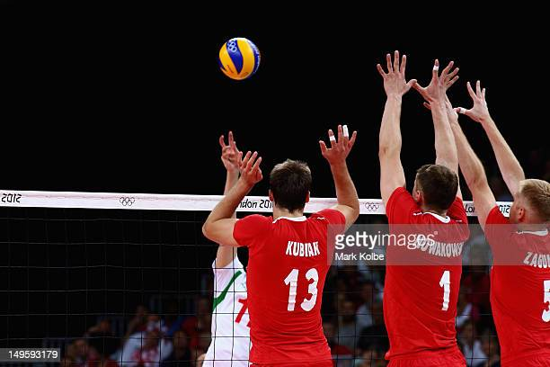 Poland's defenders block a spike during Men's Volleyball on Day 4 of the London 2012 Olympic Games at Earls Court on July 31 2012 in London England