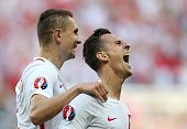 Poland's forward Arkadiusz Milik celebrates his goal with Poland's defender Artur Jedrzejczyk during the Euro 2016 group C football match between...