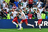 TOPSHOT Poland's forward Arkadiusz Milik is congratulated by teammates after scoring a goal during the Euro 2016 group C football match between...