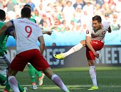 Poland's forward Arkadiusz Milik shoots to score during the Euro 2016 group C football match between Poland and Northern Ireland at the Allianz...
