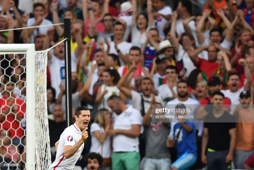 Poland's forward Robert Lewandowski celebrates after scoring the first goal during the Euro 2016 quarter-final football match between Poland and Portugal at the Stade Velodrome in Marseille on June 30, 2016. / AFP / BERTRAND