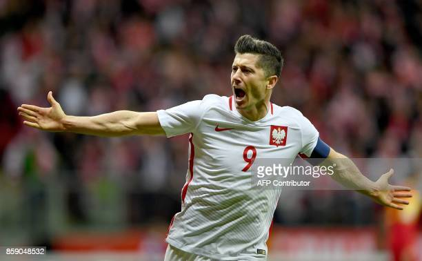 Poland's forward Robert Lewandowski reacts after he scored a goal during the FIFA World Cup 2018 qualification football match between Poland and...