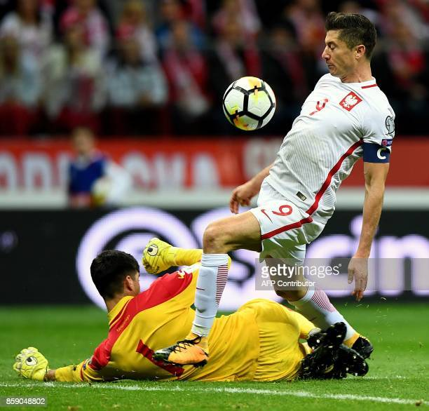 Poland's forward Robert Lewandowski scores past Montenegro's goalkeeper Daniel Petkovic during the FIFA World Cup 2018 qualification football match...