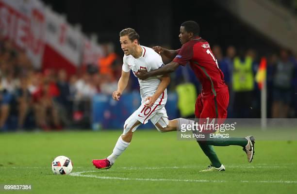 Poland's Grzegorz Krychowiak and Poland's Jakub Wawrzyniak battle for the ball