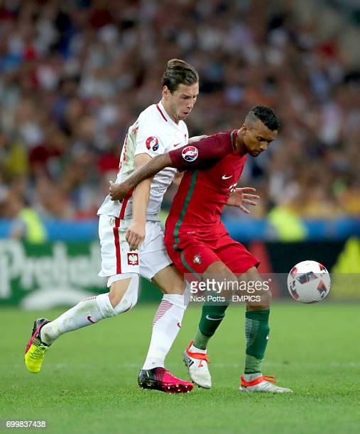 Poland's Grzegorz Krychowiak and Portugal's Nani battle for the ball