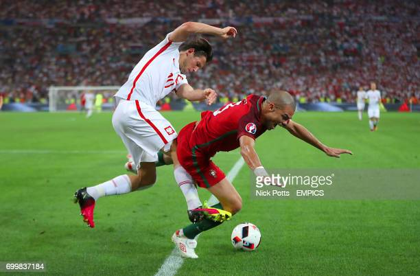 Poland's Grzegorz Krychowiak and Portugal's Pepe battle for the ball