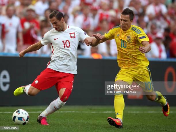Poland's Grzegorz Krychowiak and Ukraine's Yevhen Konoplyanka battle for the ball