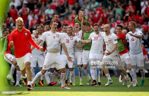 Poland's Grzegorz Krychowiak celebrates with teammates after the penalty shootout