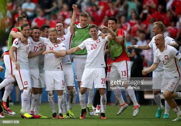 Poland's Grzegorz Krychowiak Slawomir Peszko Jakub Blaszczykowski Bartosz Salamon Lukasz Piszczek Mariusz Stepinski and Michal Pazdan celebrate...