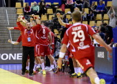 Poland's head coach Michael Biegler celebrates after his player right wing Jakub Lucak scored during the men's EHF Euro 2014 Handball Championship...