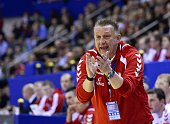 Poland's head coach Michael Biegler reacts during the men's EHF Euro 2014 Handball Championship group c match Poland vs France on January 15 2014 at...