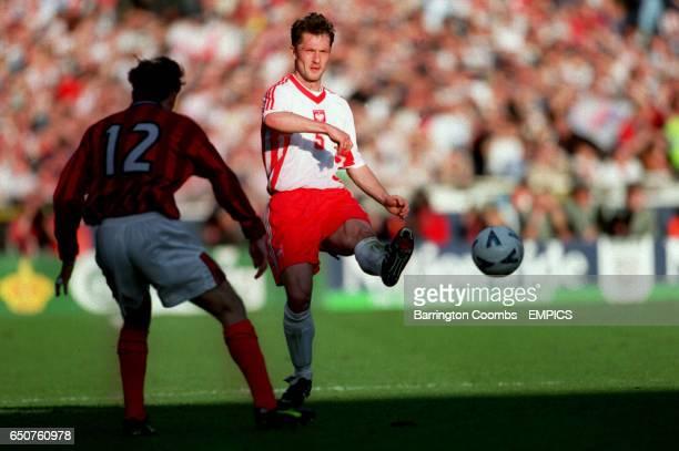 Poland's Jacek Zielinski passes the ball