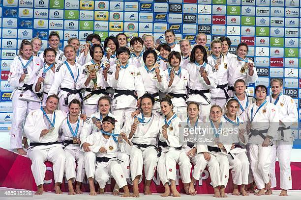 Poland's Japan's Germany's and Russia's women judo teams pose with their medals following the women's team competition at the Judo World...