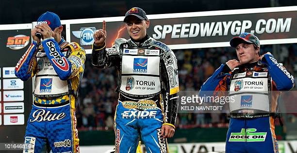 Poland's Jaroslaw Hampel signs he is number one after winning the Danish Speedway Grand Prix on the podium with second placed Tomasz Gollob of Poland...