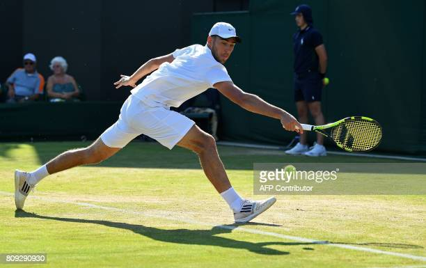 Poland's Jerzy Janowicz returns against France's Lucas Pouille during their men's singles second round match on the third day of the 2017 Wimbledon...