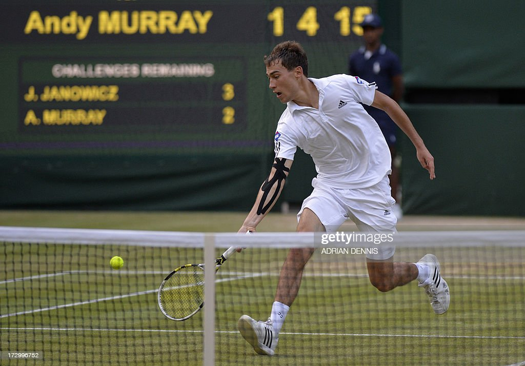 Poland's Jerzy Janowicz returns during his men's singles semi-final match against Britain's Andy Murray on day eleven of the 2013 Wimbledon Championships tennis tournament at the All England Club in Wimbledon, southwest London, on July 5, 2013. AFP PHOTO / ADRIAN DENNIS - RESTRICTED TO EDITORIAL USE
