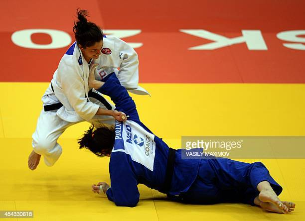 Poland's judoka Katarzyna Klys competes with Netherland's Kim Polling during the under 70 kg competition for bronze medal at the IJF World Judo...