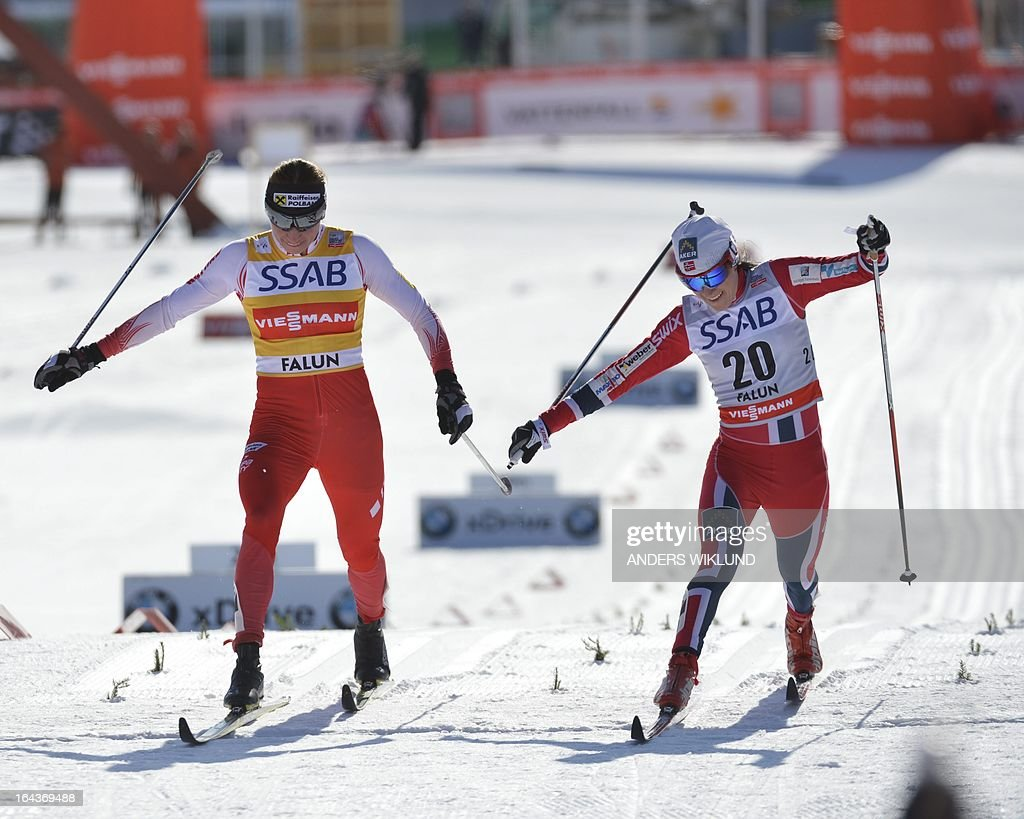 Poland's Justina Kowalczyk (L) and Norway's Heidi Weng cross the finish line during the women's 10km mass start event of the FIS Cross Country World Cup Final in Falun, Sweden, on March 23, 2013. Norway's Marit Bjoergen won ahead of Norway's Therese Johaug and Norway's Heidi Weng.