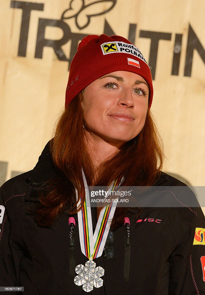 Poland's Justyna Kowalczyk poses on the podium with her silver medal at the medals ceremony of the Women's Cross Country 30 km Classic race of the FIS Nordic World Ski Championships at Val Di Fiemme Cross Country stadium in Cavalese, northern Italy, on March 2, 2013.