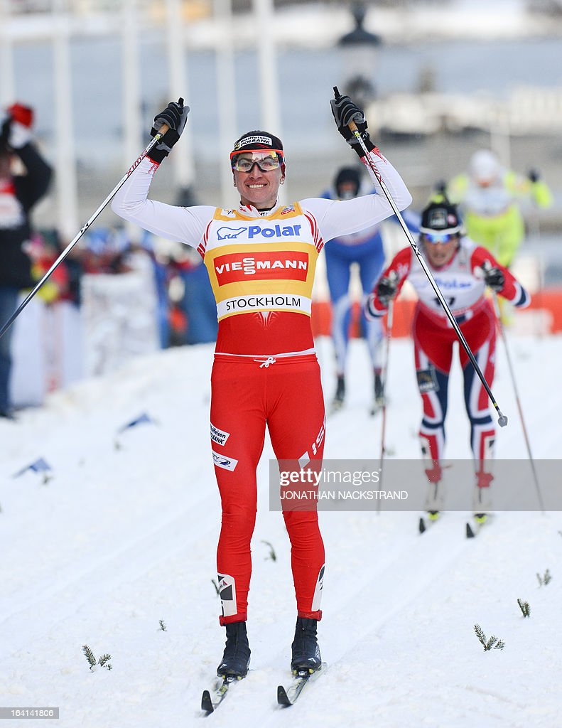 Poland's Justyna Kowalczyk reacts after crossing the finish line in the first place during the Women's 1.1 kilometer cross country World Cup Royal Palace Sprint on March 20, 2013 in Stockholm.
