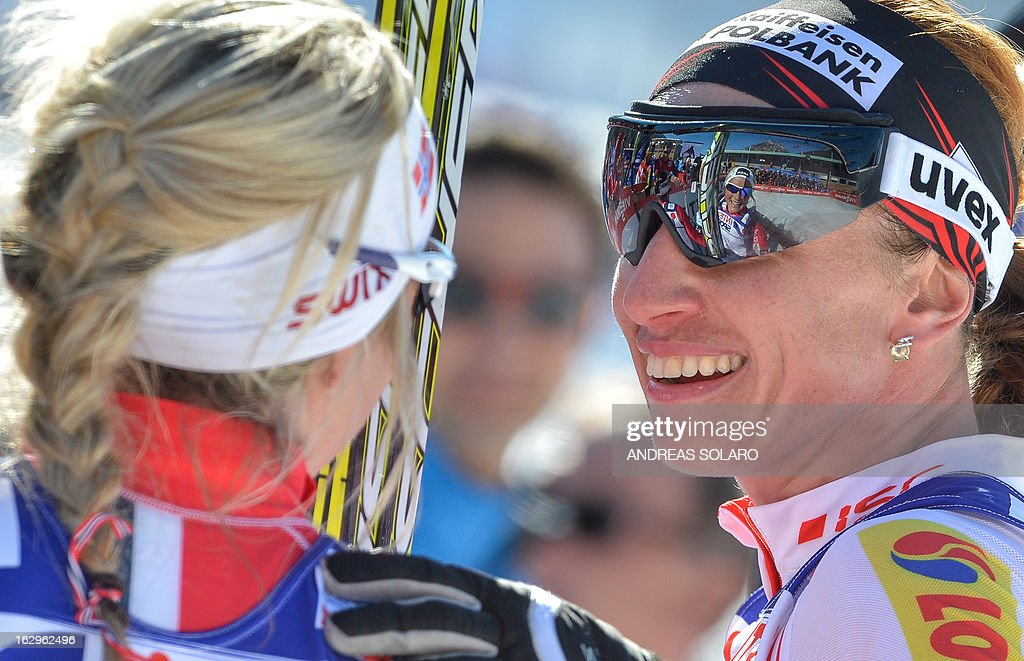 Poland's Justyna Kowalczyk (R) speaks to Norway's Therese Johaug on March 2, 2013 in the finish area after the Women's Cross Country 30 km Classic race of the FIS Nordic World Ski Championships at Val Di Fiemme Cross Country stadium in Cavalese, northern Italy. Marit Bjoergen of Norway came in first, with Kowalczyk and Johaug coming in second and third respectively.