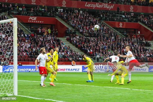 Poland's Kamil Glik scoring his side's second goal with Robert Lewandowski Piotr Zielinski and Arkadiusz Milik during the FIFA World Cup 2018...