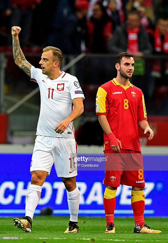 Poland's Kamil Grosicki (L) celebrates scoring the 2-0 next to Montenegro's Marko Jankovic during the FIFA World Cup 2018 qualification football match between Poland and Montenegro in Warsaw on October 8, 2017. /