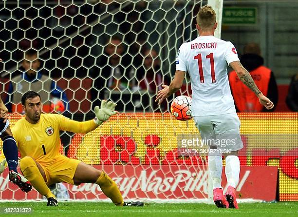 Poland's Kamil Grosicki scores a goal past Gibraltar's goalkeeper Jordan Perez during the UEFA Euro 2016 qualifying football match between Poland and...