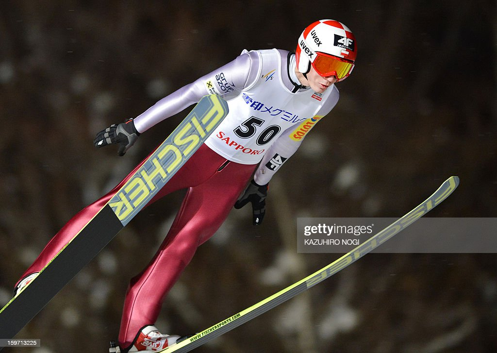 Poland's Kamil Stoch jumps during the Ski Jumping World Cup competition in Sapporo, Hokkaido prefecture on January 19, 2013. Stoch placed ninth in the event with a total of 233.1 points. AFP PHOTO / KAZUHIRO NOGI