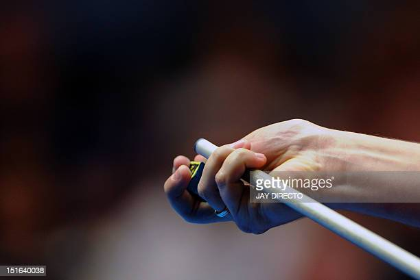 Poland's Karol Skowerski applies chalk on his cue stick on September 9 2012 during the finals of the 2012 PartyPokernet World Cup of Pool in Manila...