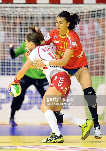 Poland's Karolina Kudlacz is fouled by Spain's Elisabet Chavez during the first match Spain vs Poland of the 2014 European Women's Handball...