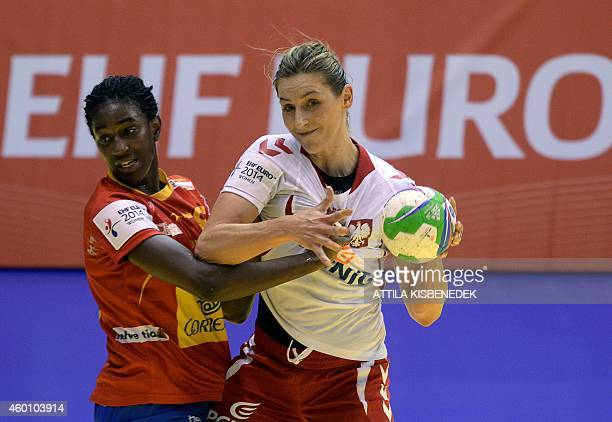 Poland's Katarzyna Janiszewska vies for the ball with Spain's Alexandrina Cabral during the first match Spain vs Poland of the 2014 European Women's...