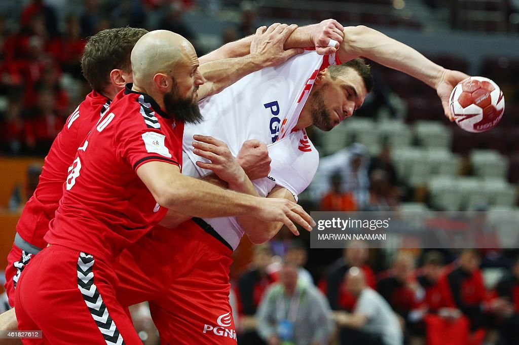 Poland's Krzysztof Lijewski fights for the ball during the 24th Men's Handball World Championships preliminary round Group D match between Poland and...