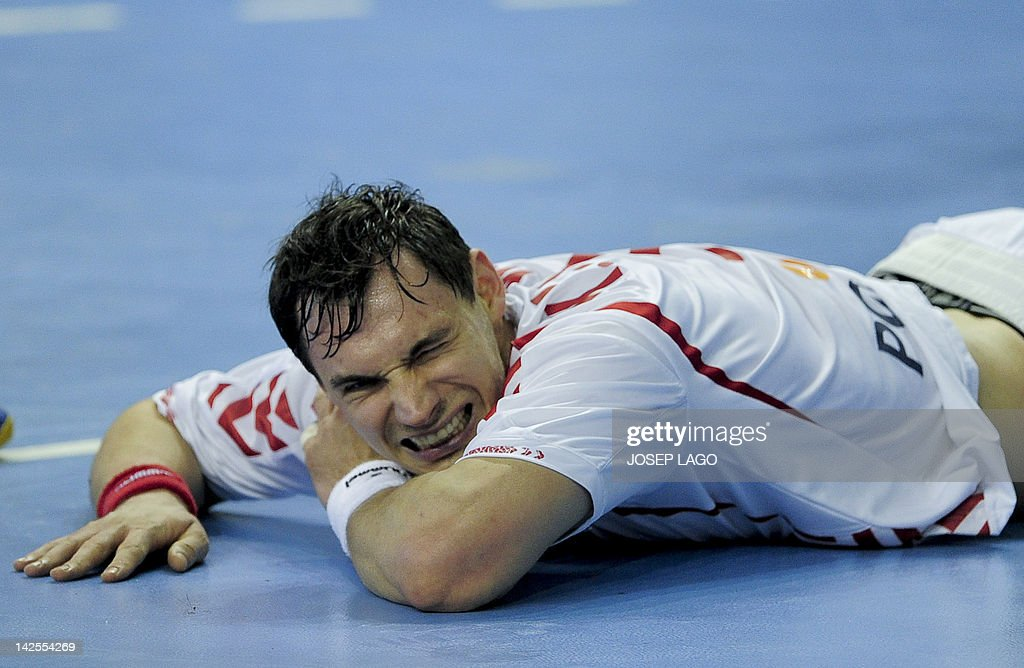 Poland's Krzysztof Lijewski reacts during the handball pre-Olympic qualifying match Serbia vs Poland on April 7, 2012 at the Tecnificacion Center sports hall in Alicante. The match ended in a 25-25 draw.