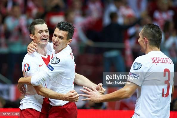 Poland's Krzysztof Maczynski celebrates with teammates after scoring during the UEFA EURO 2016 qualifying match between Poland and Scotland on...